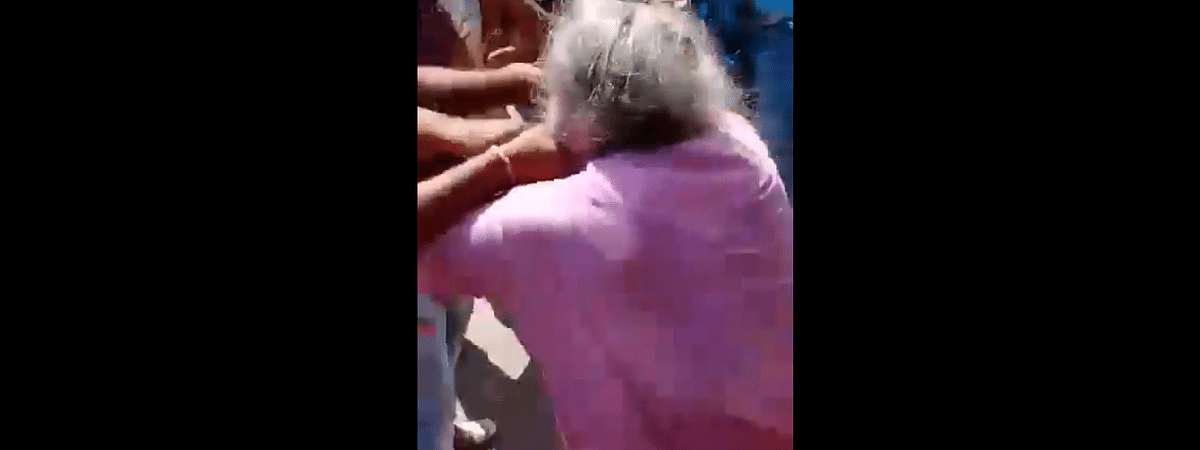 In the video, an old man is seen being beaten up by some youths