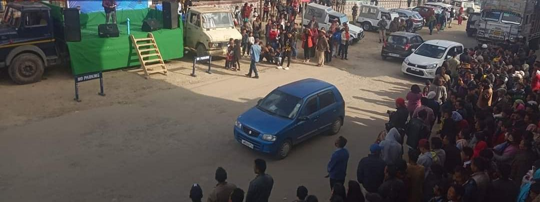 People participate in a roadshow, organised by Ukhrul Traffic Police, at Ava market on Tuesday