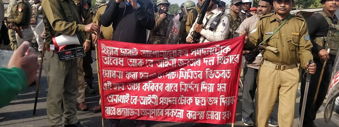 A district administration official making announcement on National Highway 37 near Bokul in Assam's Dibrugarh district appealing CAB protesters to remove the blockade