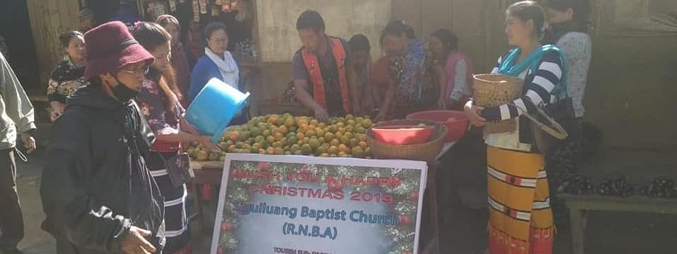 Locals offering free oranges to commuters in Tamenglong district