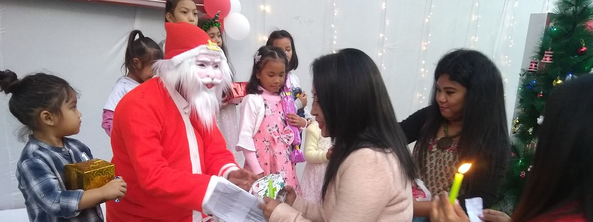 Santa Claus distributing Christmas presents to participants at Advent Christmas celebration at Meghalaya House in New Delhi recently