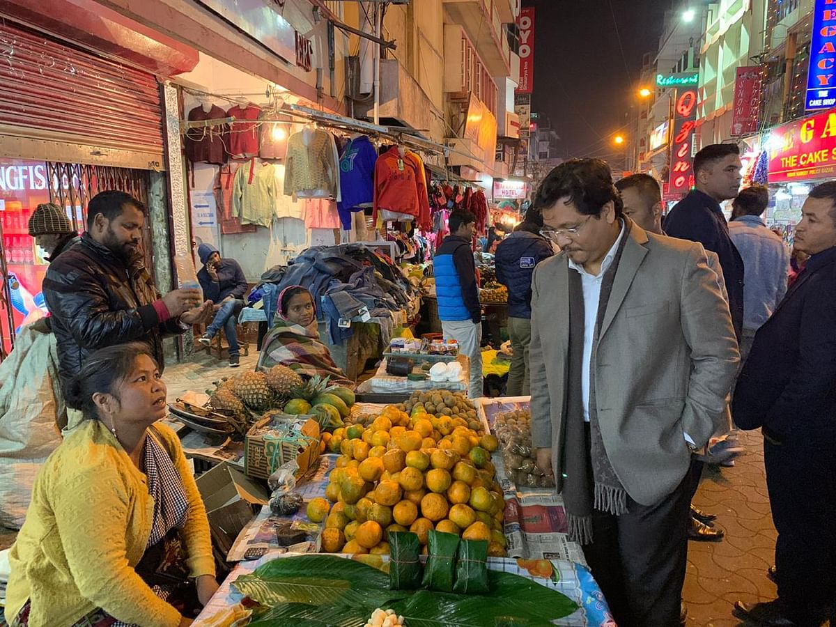 Meghalaya CM Conrad Sangma speaking to vendors in Police Bazar, Shillong on Friday.