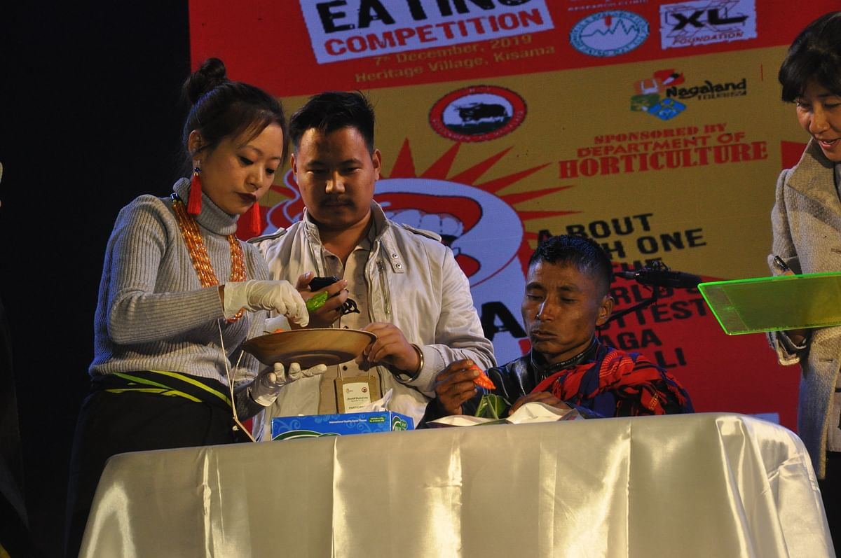 Moba Chang from Tuensang, who won in the 'local' category of Naga chilli-eating competition at Hornbill Festival 2019. He ate seven king chillies in 20 seconds