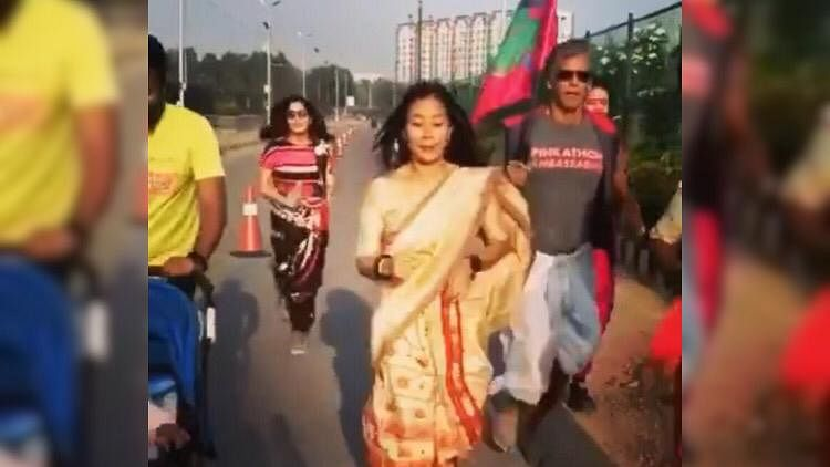 Ankita Konwar and Milind Soman in traditional attire during a recent run