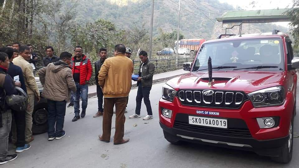 Sikkim minister Sanjit Kharel getting his government vehicle checked by a mobile squad during an enforcement drive in Gangtok