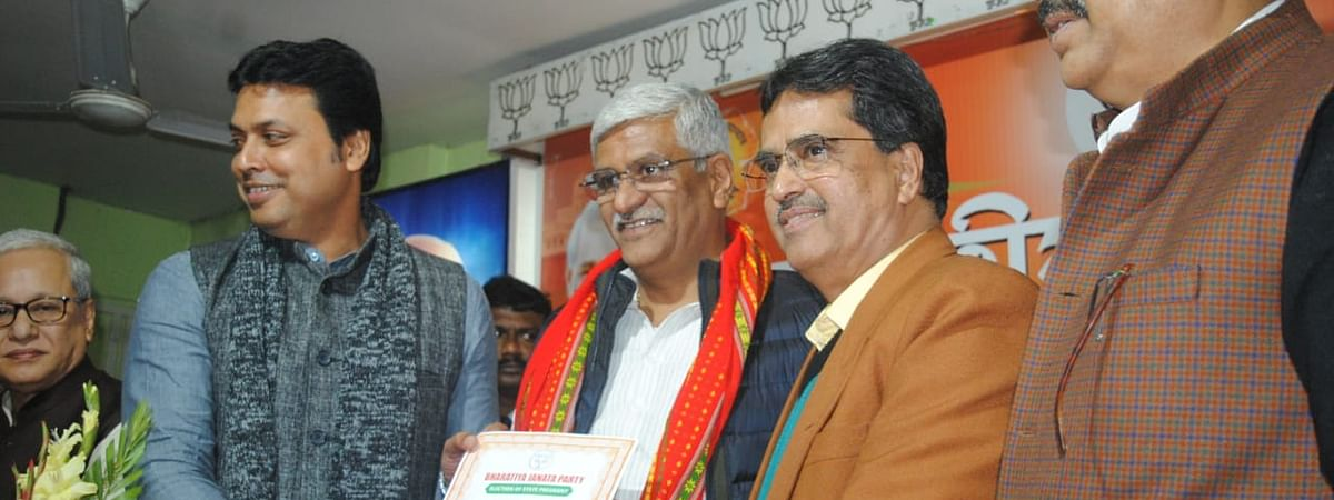 Dr Manik Saha (brown jacket) being appointed as the new state president on Wednesday