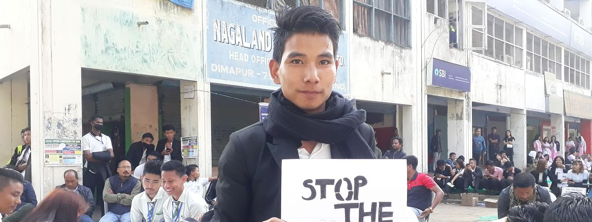 An artist displaying his painting at a protest organised by Nagaland Against CAA in Dimapur recently
