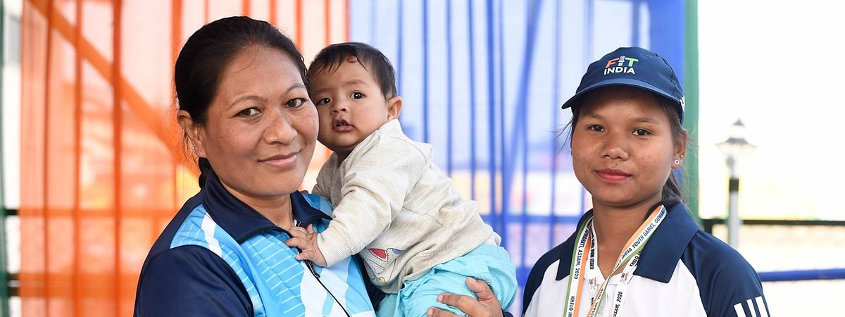 Jinu Gogoi (right) with her employer Bima Borah and her 10-month-old baby whom she used to babysit