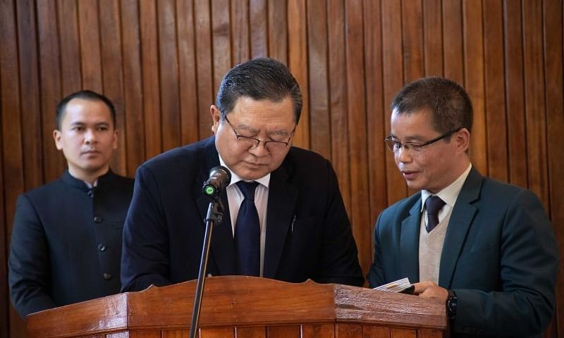 Lalramthanga Tochhawng (centre) being sworn in as the new MPSC chairman