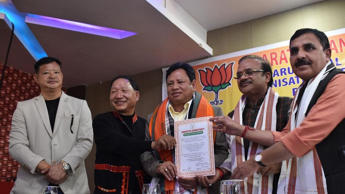 Biyuram Wahge (centre) being handed over the certificate of election as the new president of Arunachal Pradesh BJP on Friday