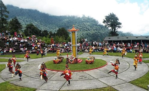 Dancers perform the Pangtoed Chaam at a monastery