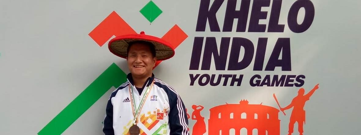 Pemba Tshering Sherpa bagged a bronze medal in the U-21, 81-kg men's weightlifting event at 3rd Khelo India Youth Games in Guwahati on Monday