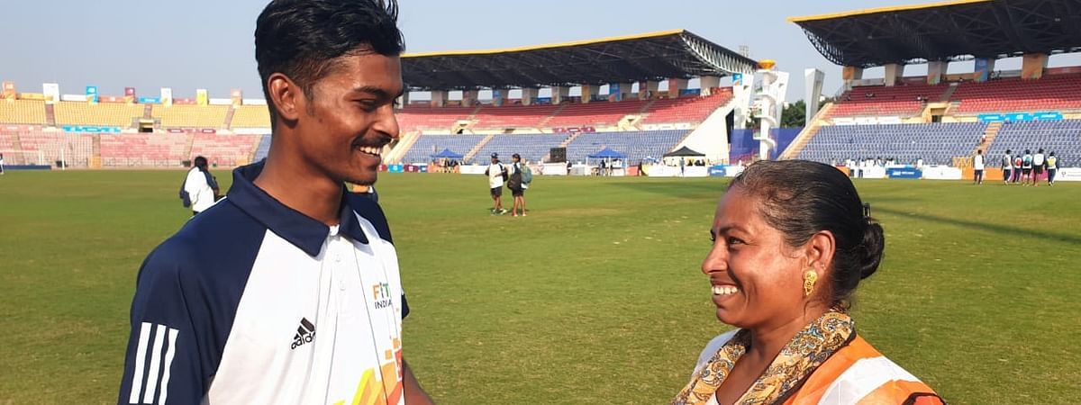 Poornima Mondol chats with one of her sons during the 3rd Khelo India Youth Games 2020 in Guwahati, Assam