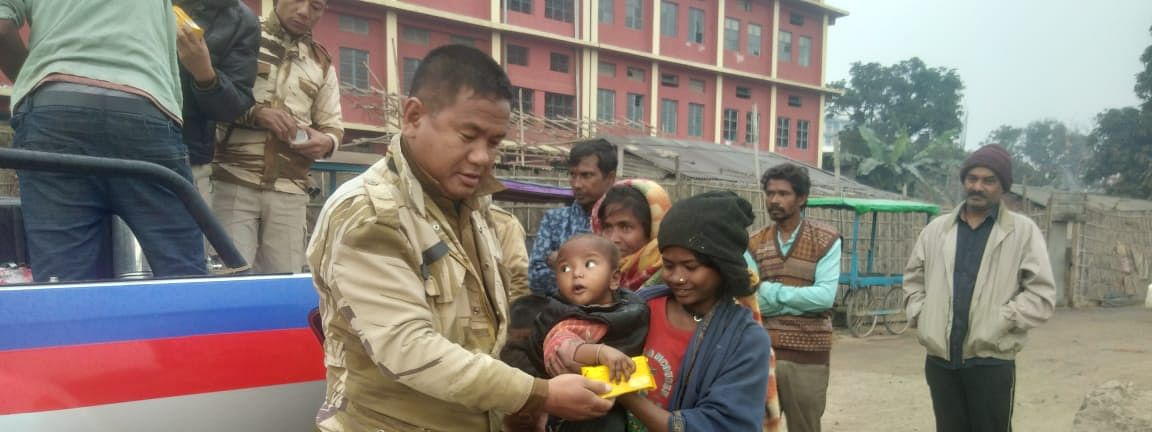 A policeman offering snacks to a homeless girl in Dimapur, Nagaland on Wednesday