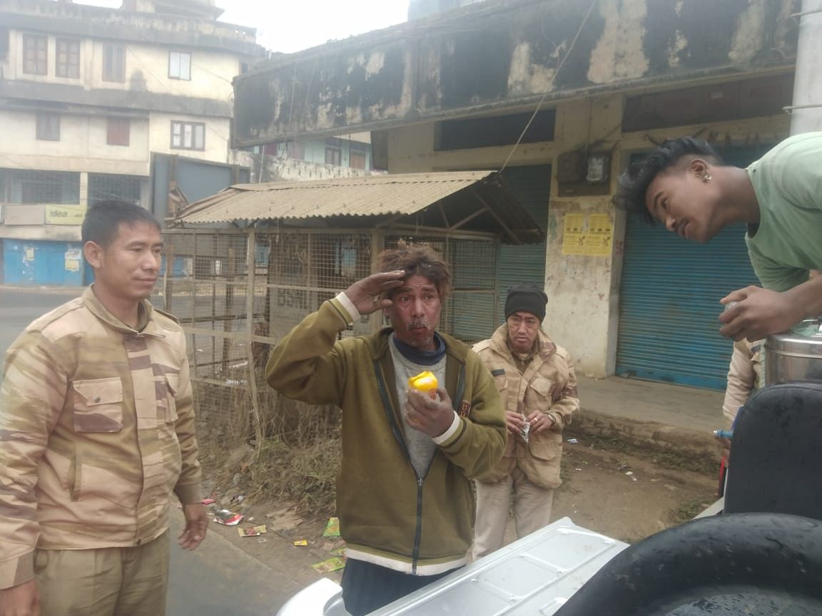 A homeless person saluting the police personnel for their act of kindness in Dimapur, Nagaland