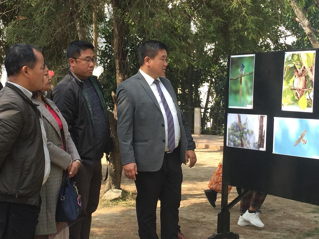 Minister Lalruatkima checking out the photo exhibition