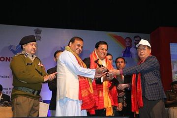 NDFB (P) head Dhiren Bodo handing over his weapon to Assam CM Sarbananda Sonowal and minister Himanta Biswa Sarma