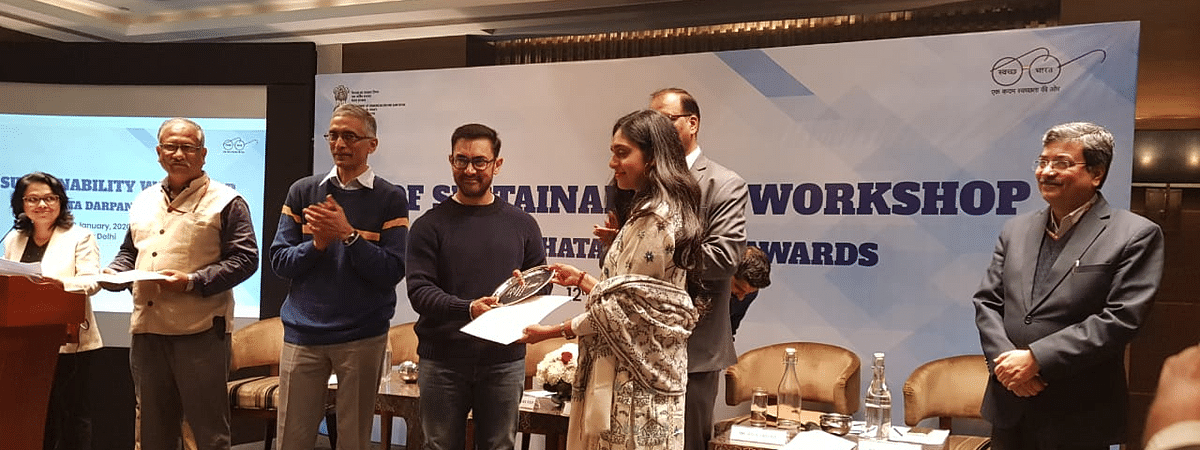 Bollywood superstar Aamir Khan giving away the award to West Kameng  DC Sonal Swaroop in New Delhi on Saturday