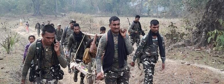CRFP jawans carrying a pregnant woman on cot in Bijapur district of Chhattisgarh on Tuesday