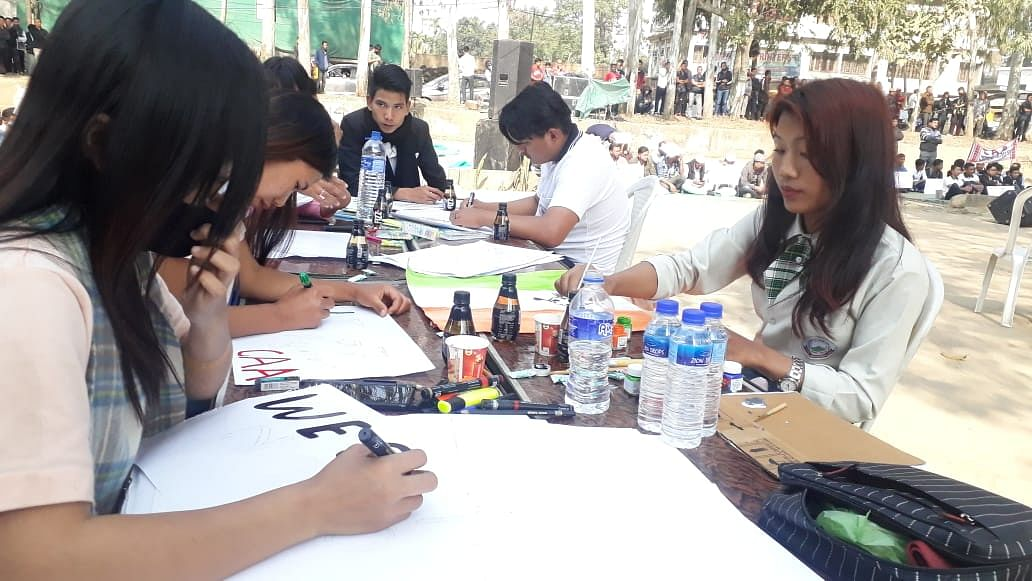 A painting competition themed around Citizenship (Amendment) Act in progress at the public protest rally in Dimapur, Nagaland on Saturday