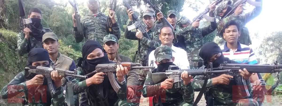 B Saoraigwra, chairman of Saoraigwra faction of the National Democratic Front of Boroland is seen (wearing white shirt) along with some armed members of the outfit in an undisclosed location