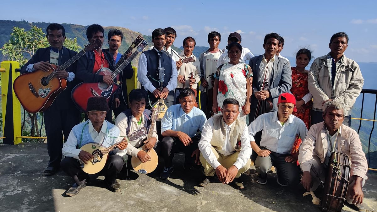 The 16-member orchestra of Nohron in Meghalaya poses for a group picture