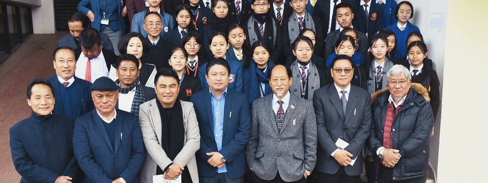 Chief minister Neiphiu Rio and others, along with the meritorious students at Capital Convention Centre in Kohima on Friday