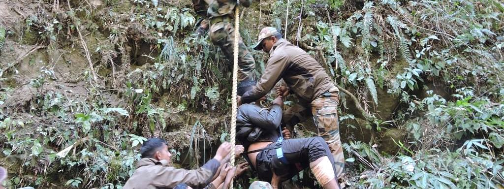 Army launching rescue operation at a gorge along NH 113 between Hayuliang and Hawai in Arunachal Pradesh and rescuing one of the injured persons