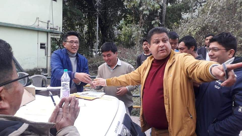 Sikkim transport minister Sanjit Kharel getting his official vehicle checked by enforcement officials in Gangtok
