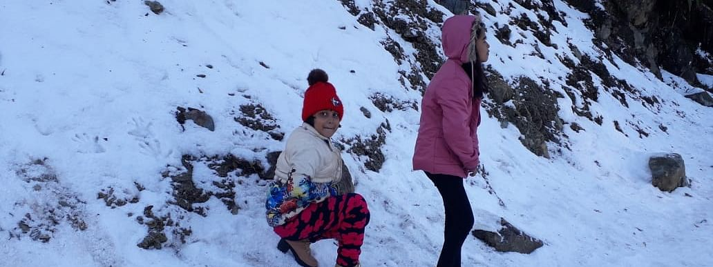 Kids playing with snow at Mayodia Pass in Arunachal Pradesh's Lower Dibang Valley district