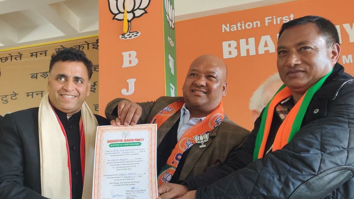 New state BJP president Ernest  Mawrie given the certificate of appointment by MLA AL Hek (right) and BJP national secretary Sunil Deodhar (Left)