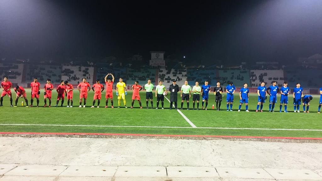 Ahead of the match, both teams pose for lens