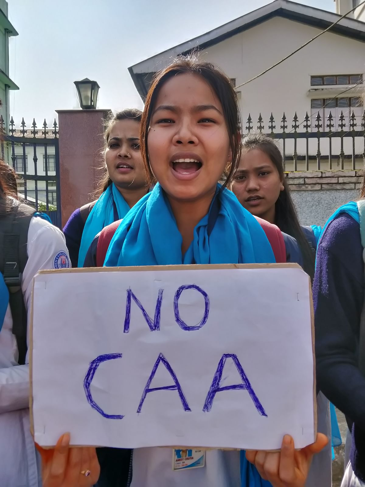 A college student in Tinsukia holding 'No CAA' placard