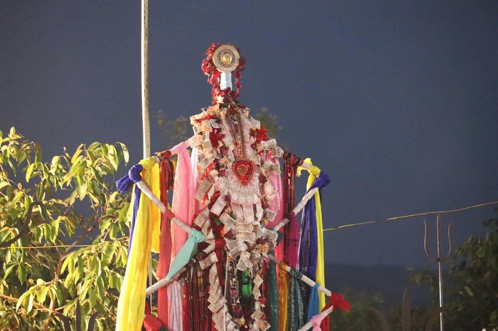A bamboo pole symbolizes Lord Garia, also known as the deity of livestock and wealth