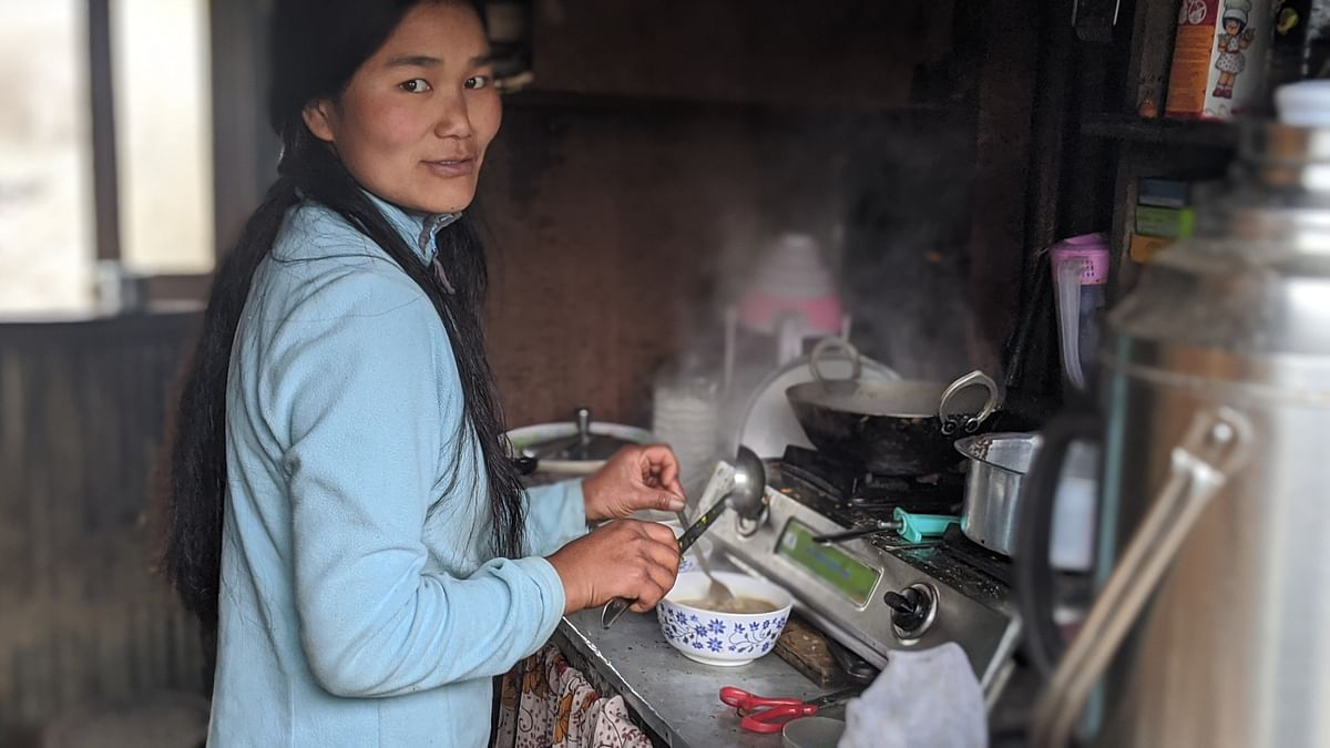 Doma prepares a hot bowl of instant noodle soup for trekkers who halt at Kaiya Kata for a quick lunch before proceeding to Kalpokhari, Nepal