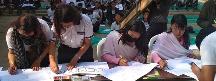 Students making placards during the public rally in Nagaland's Dimapur on Saturday