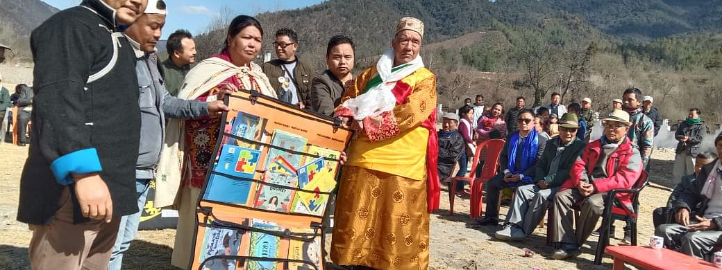 Garung Thuk NGO handing over books to government schools on Republic Day.
