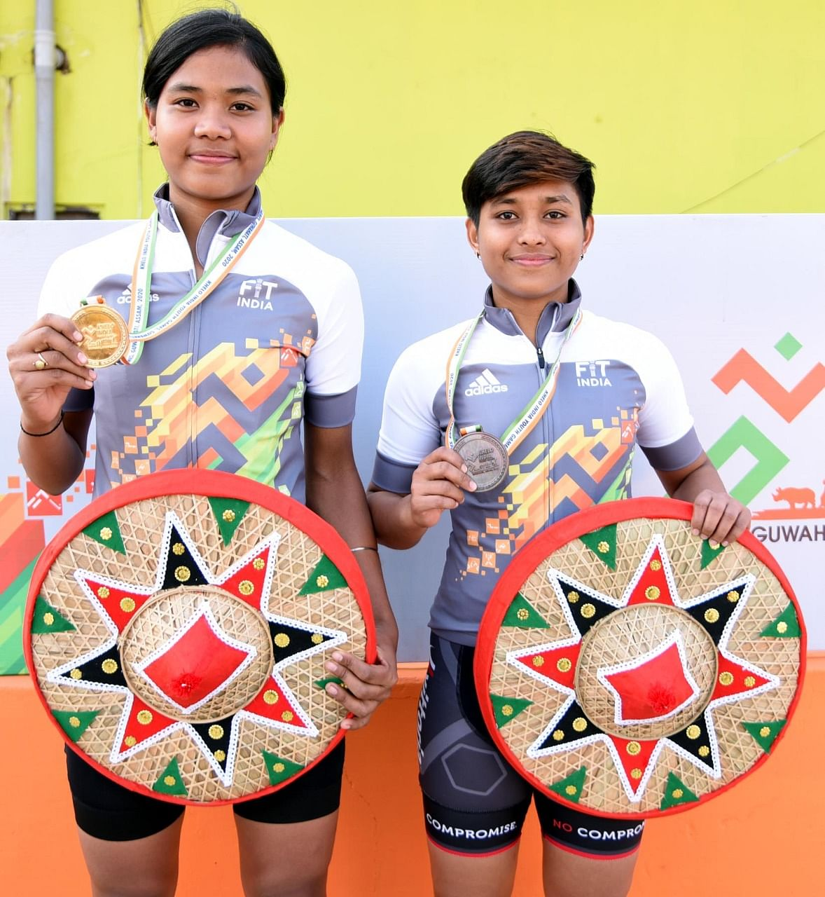 Assam's Gongutri Bordoloi and Chayanika Gogoi displaying their gold and bronze medals, respectively, in the girls' U-21 100-km cycling event at the ongoing 3rd Khelo India Youth Games 2020