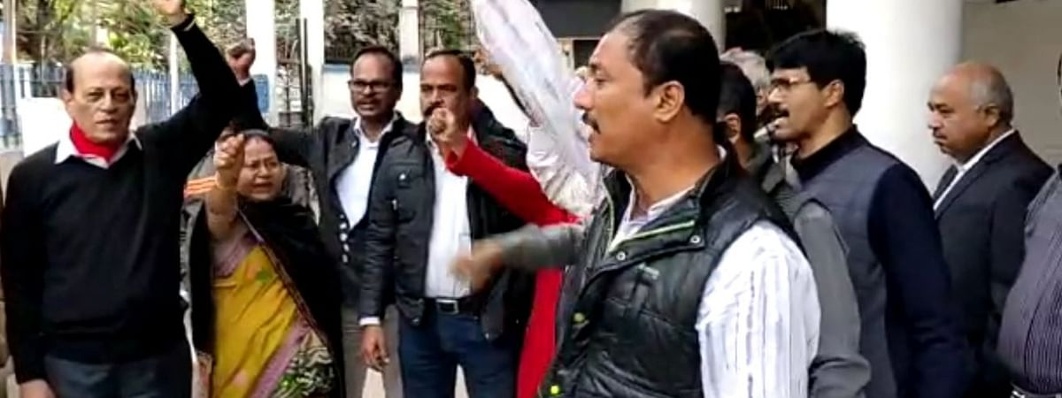 AGP city unit members sounding slogans against the party leadership in Guwahati on Thursday