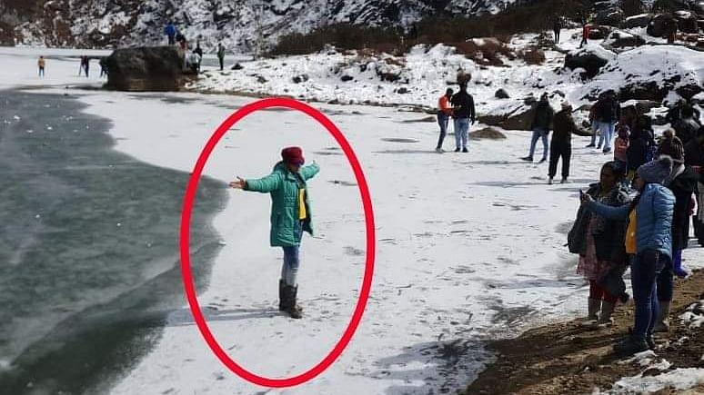 Picture of this tourist posing near the thin layer of ice on Tsomgo Lake in East Sikkim is doing the rounds of social media