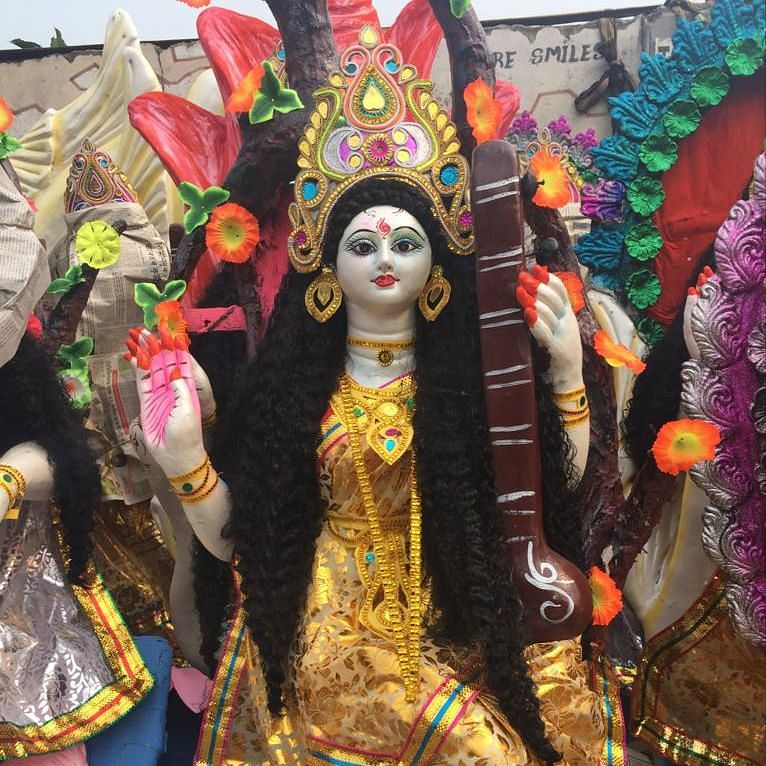 Puja pandals were decorated with bright and vibrant hues of yellow to pay obeisance to the Goddess on Wednesday morning