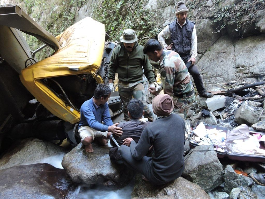 A team of Army personnel giving first-aid to an injured person