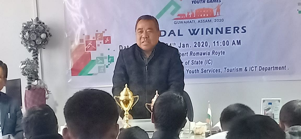 Mizoram sports minister Robet Romawia Royte giving a speech at the felicitation programme on Friday