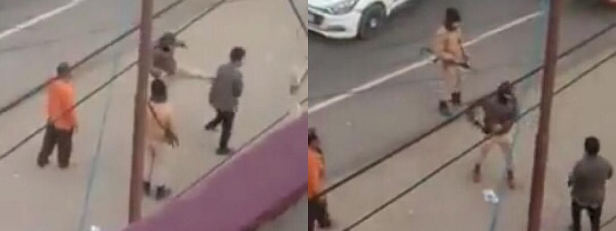 The assistant sub-inspector was also seen threatening the man with a loaded gun