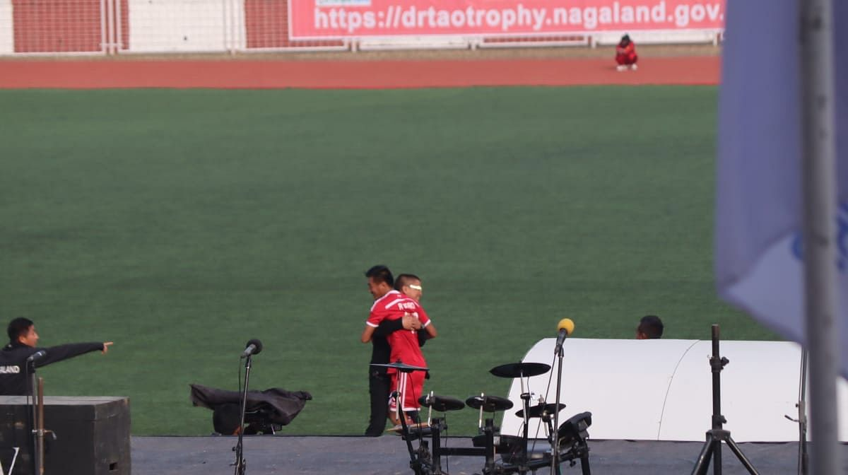 Nagaland's team manager Colo Mero congratulates Rhitso Mero immediately after the first score in favour of Nagaland
