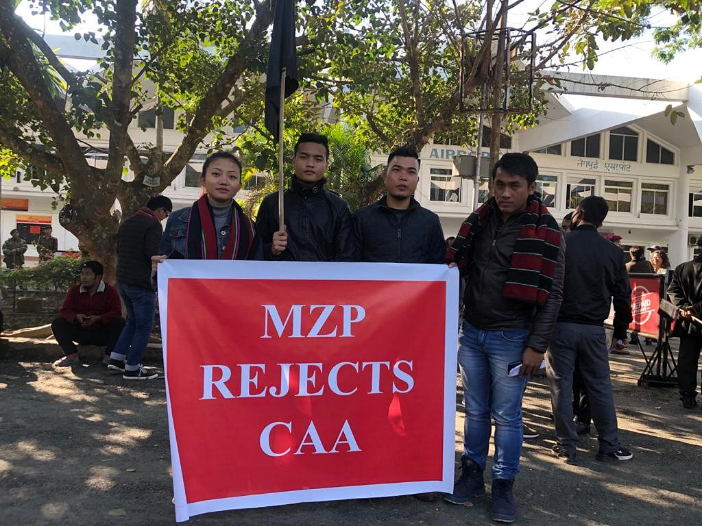 Members of Mizo Zirlai Pawl holding an anti-CAA banner at Lengpui Airport in Aizawl on Tuesday