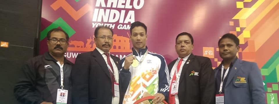 19-year-old weightlifter Gulap Gogoi posing with his coach and family members after clinching gold medal at Khelo India Youth Games 2020 in Guwahati
