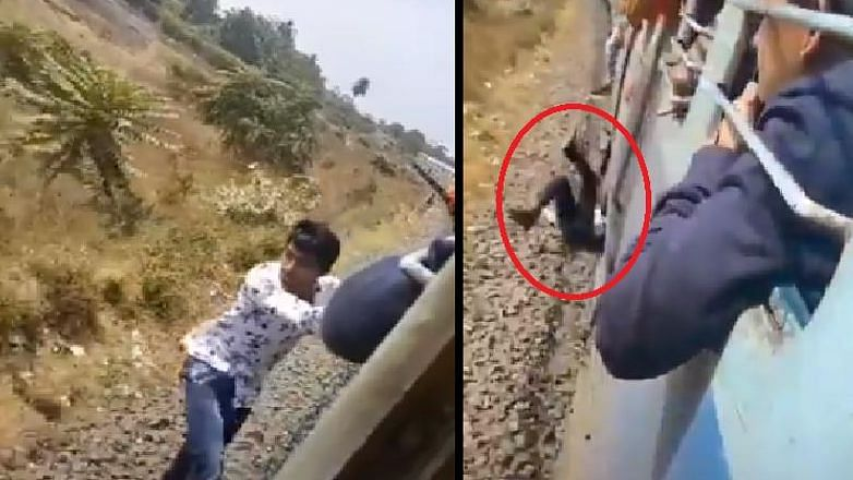 The man escapes death by a whisker as eventually stands up and appears to be unhurt after falling off the running train