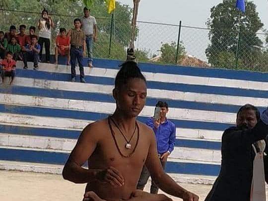 Meet this Assam youth who pulls truck, bus with his hair power