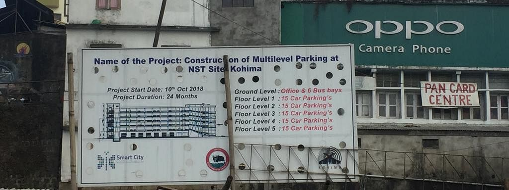 A hoarding of the multi-level car parking project on display at the NST site in Kohima